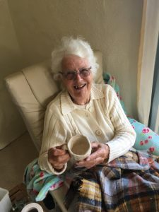 Woman holding out her finished cup