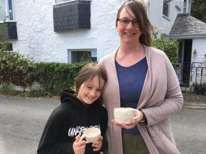 Mother and daughter presenting their finished cups